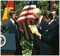 Tolzmann and Reagan in a color photo from 1987